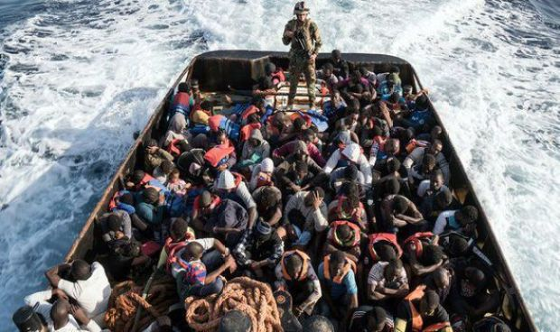 Migrants on a boat to Italy