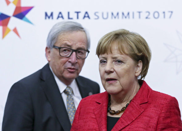 Jean-Claude Juncker with Angela Merkel in Malta