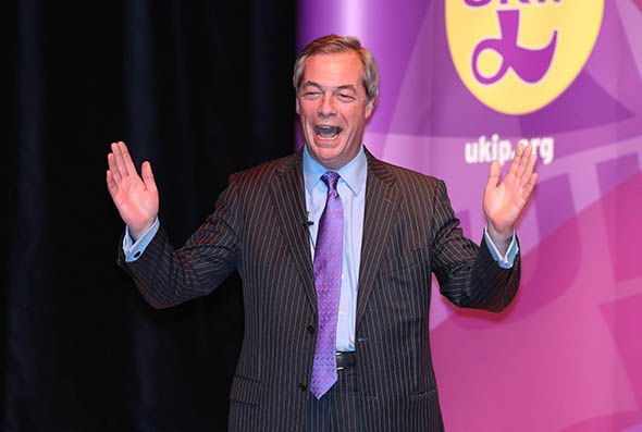 Nigel Farage on stage campaigning in Stoke