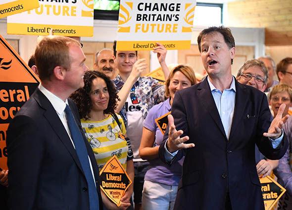 Nick Clegg speaking with Tim Farron