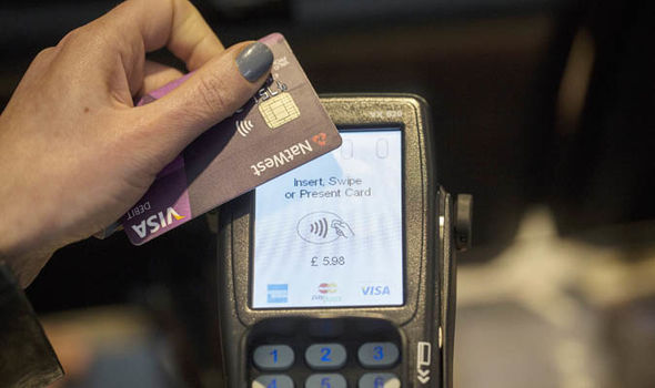 Person paying with contactless card  Debit and credit card surcharges ban to take effect today | Politics | News credit card 1192473