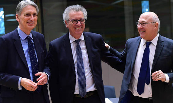 UK Finance Minister Philip Hammond (L), Luxembourg's Finance Minister Pierre Gramegna (C) and French Finance Minister Michel Sapin