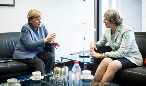may and merkel  Brexit news: Boris condemns Remainer plot to stop EU exit | Politics | News may and merkel 1232437