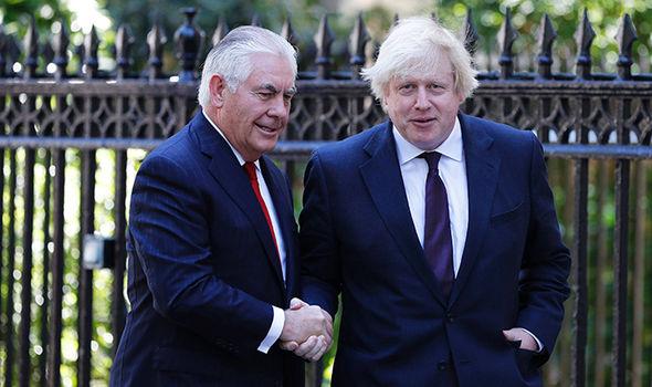 Rex Tillerson shakes hands with Boris Johnson