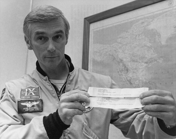 Mr Cernan holds piece of paper