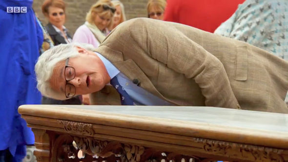 Christopher Payne inspects the £20,000 table on Antiques Roadshow