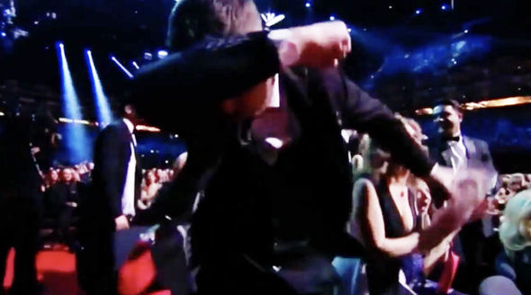 Danny Miller done a dab dance move