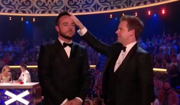 Dec puts his hands on Ant's head