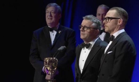 Simon Pegg and Nathan Lane present an award at the BAFTAs 2017