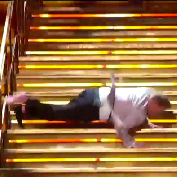 James Corden falls down stairs