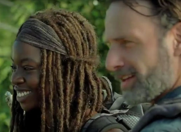 Rick and Michonne from The Walking Dead smiling