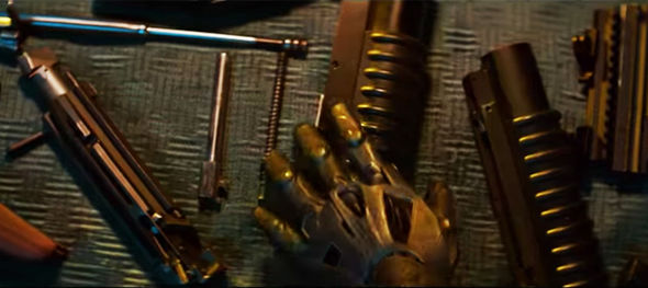 cable's hand on a gun