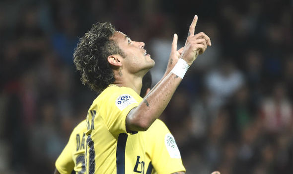 Neymar celebrates scoring on his PSG debut