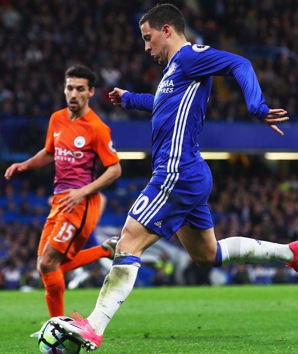 Eden Hazard in action against Manchester City