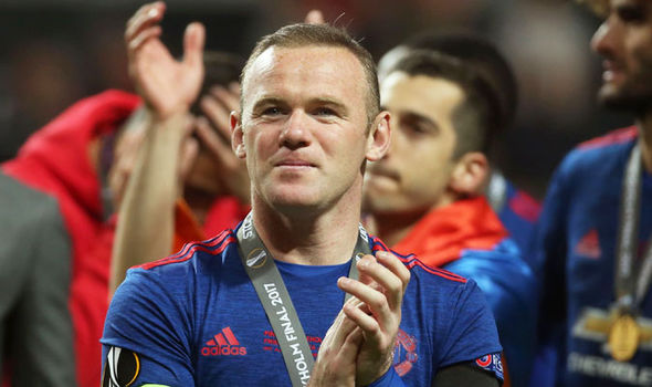 Wayne Rooney winning the Europa League with Manchester United