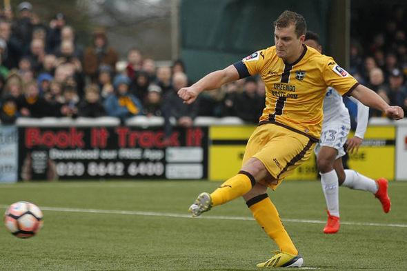 Sutton United's Jamie Collins scores