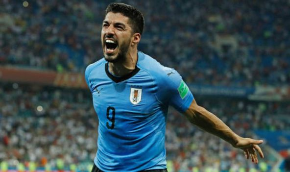 Image result for pic of luis suarez in uruguay color