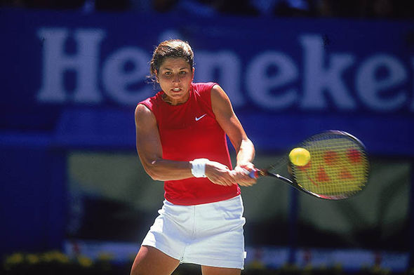 Mirka Federer playing tennis