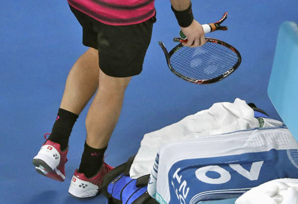 Stan Wawrinka smashes a racket
