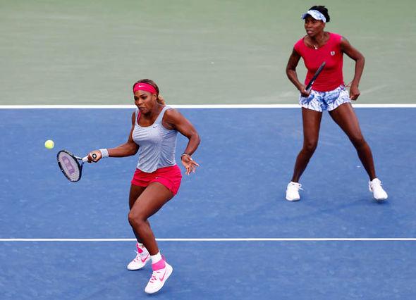 Venus and Serena Williams playing tennis