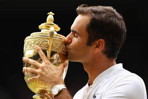 Roger Federer kissing the Wimbledon trophy