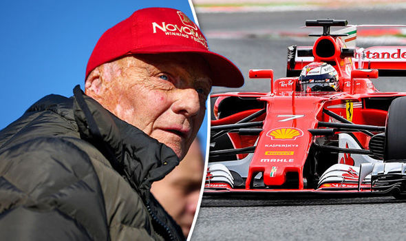 Mercedes boss Niki Lauda and the Ferrari F1 car