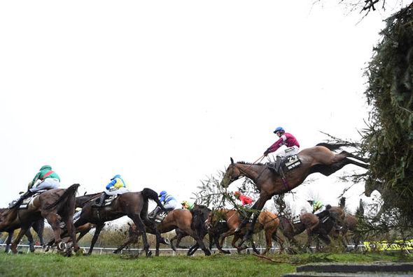 Grand National 2016 runners clearing a fence