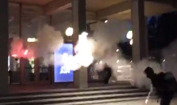 Anti-Trump protestors throw flares across campus