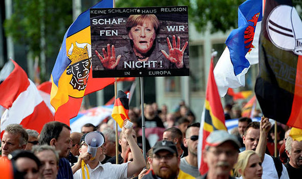 Germans protesting against Merkel's migration policy