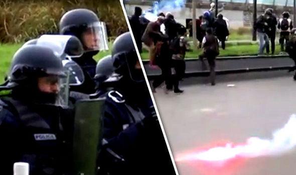 Armed police in Paris as flares thrown
