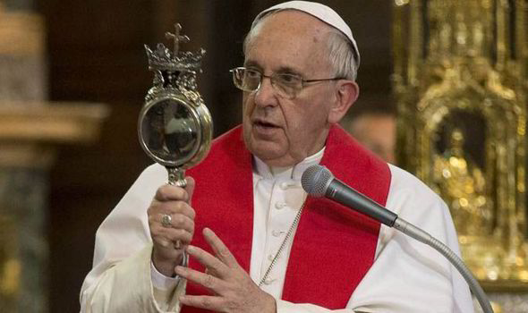 Pope Francis looking at a sealed glass ampoule