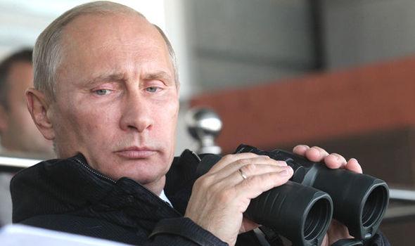 Russian President Vladimir Putin holding binoculars