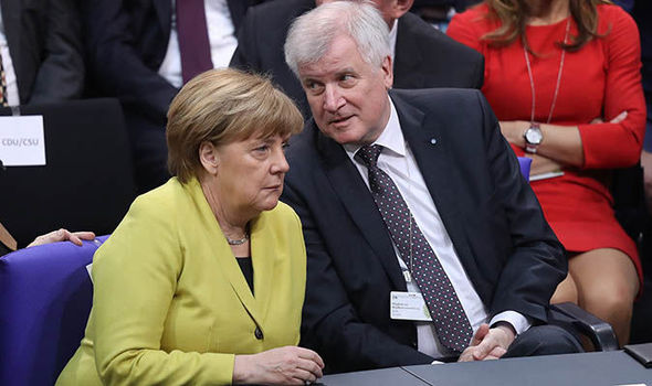 Horst Seehofer speaking with Angela Merkel