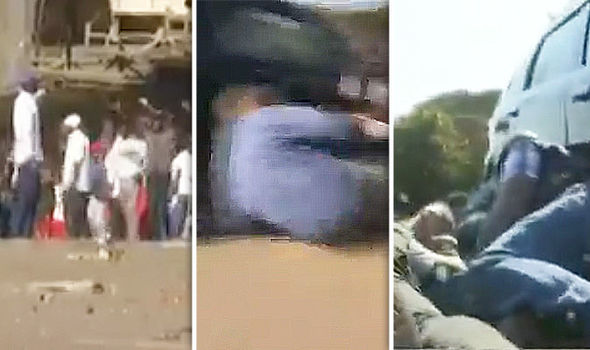 Zimbabwe news - Men hide behind parked car