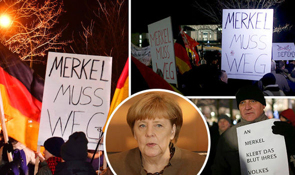Protests have erupted outside Angela Merkel's office in Berlin