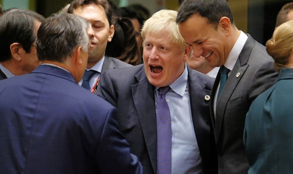 Boris Johnson celebrating the NI Protocol agreement with EU leaders in 2019