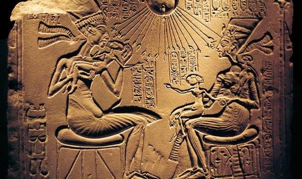 Akhenaten and Nefertiti depicted on a stone slab