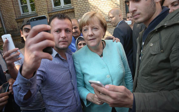 Angela Merkel on a visit to a migrant shelter