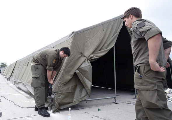 Members of the Austrian Army set up tents in Nickelsdorf, Austria