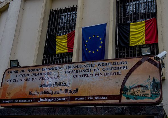 Belgian and EU flags arer displayed above the entrance to the Grand Mosque in Brussels