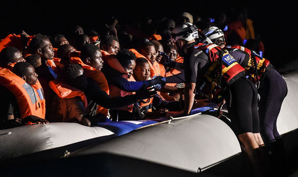 Migrants flood into EU through Italy