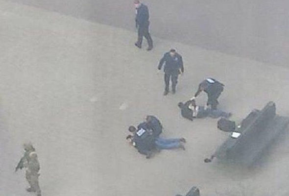 Armed police arrest two men near the metro station