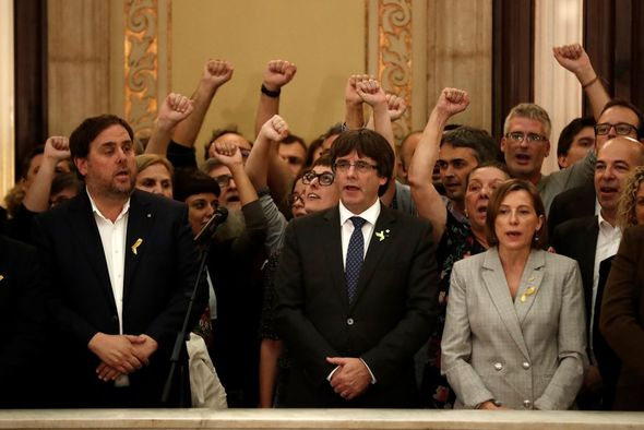 Carles Puigdemont with members of the Catalan government after they declared independence
