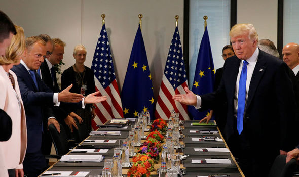 Donald Trump and Tusk gesture at each other before meeting
