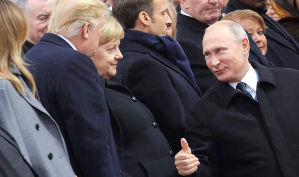 Donald Trump with Putin at the Remembrance service