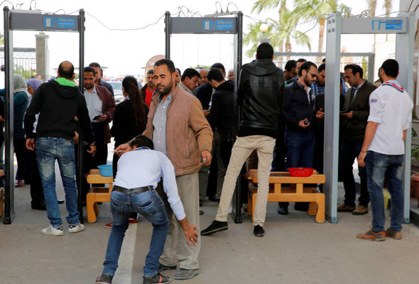 Mourners undergo a security check before attending the funeral of the victims of Palm Sunday attacks