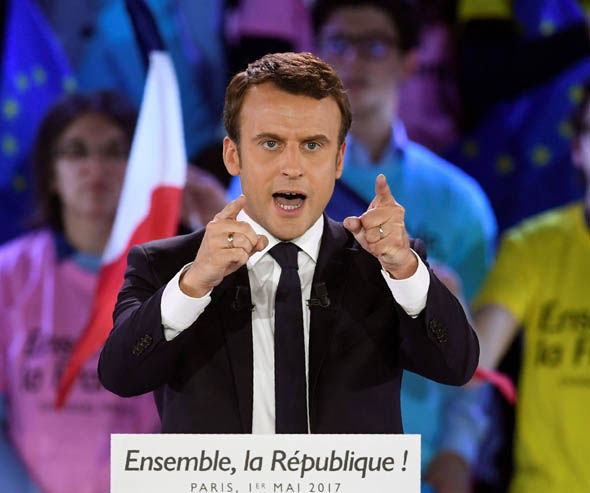 Emmanuel Macron at a party rally