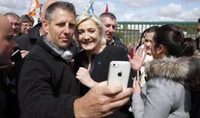 Image result for Le Pen taking selfies with workers