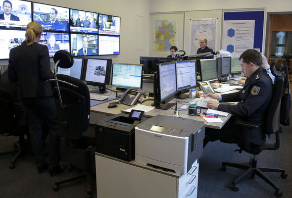 Staff work at the Emergency Operations Centre during the anti-terror drills