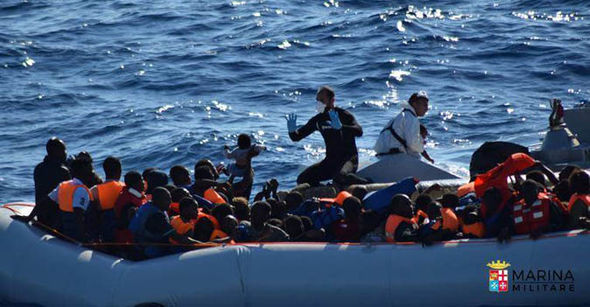 Hundreds of migrants on a boat